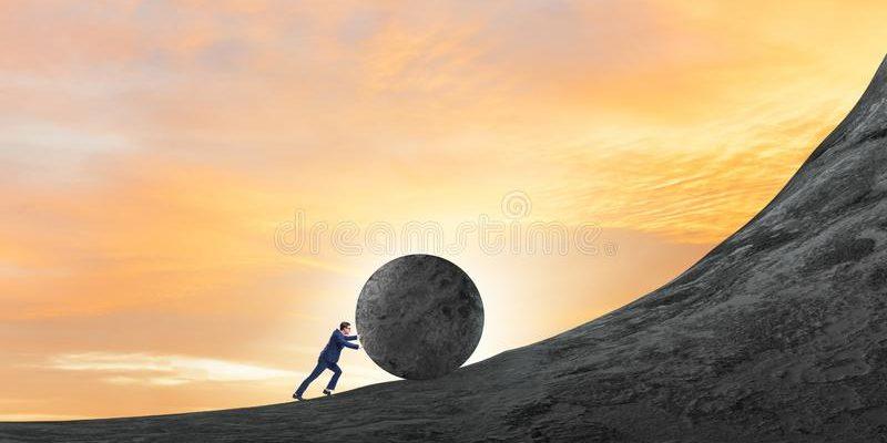 man-pushing-large-stone-to-top-159719585